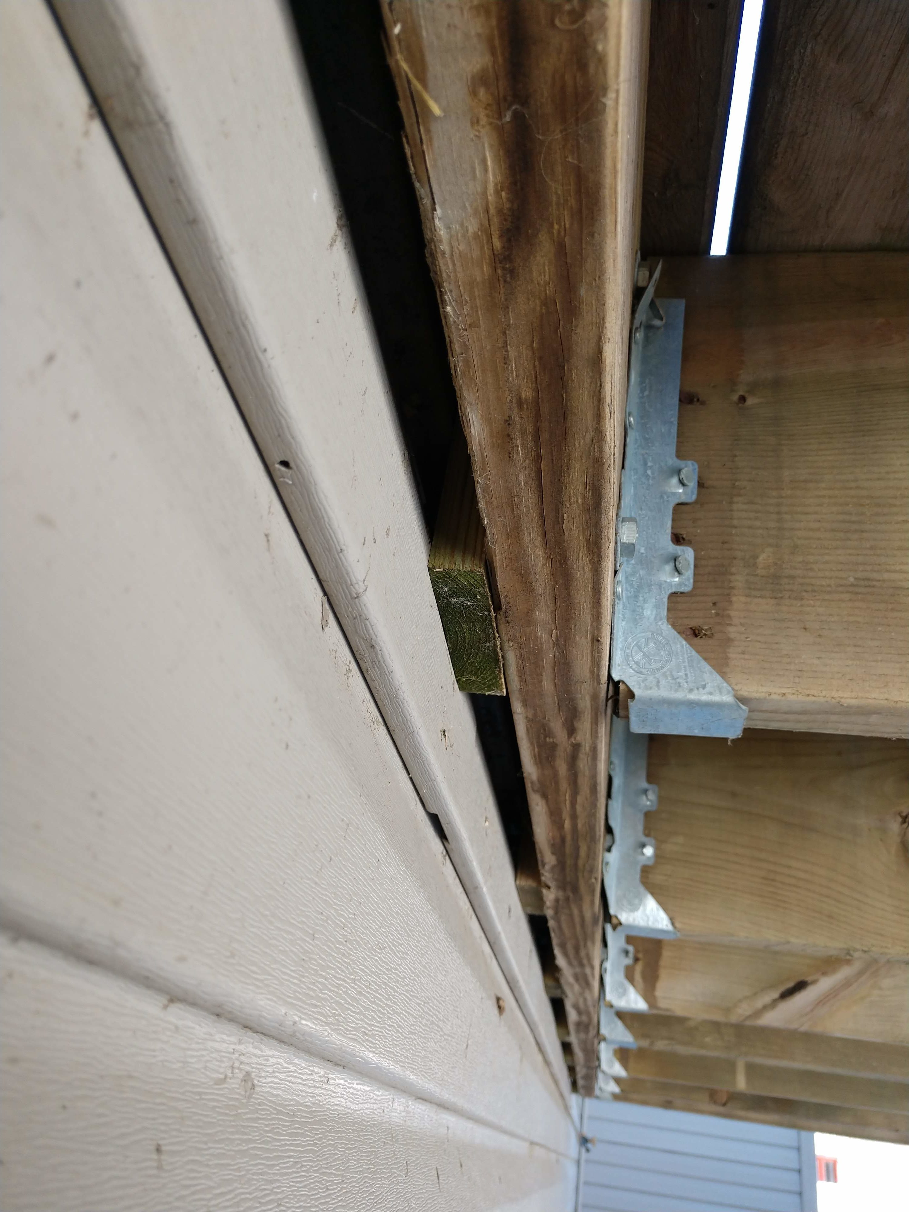 No ledger board. Deck is screwed to the siding using lag bolts.